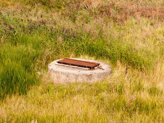 sewer bunker grate top in field country
