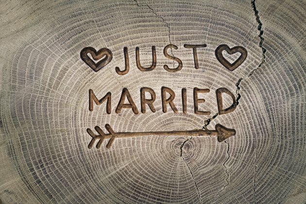 Woodcarving. Newlyweds, Just married, inscription on the wedding. Background