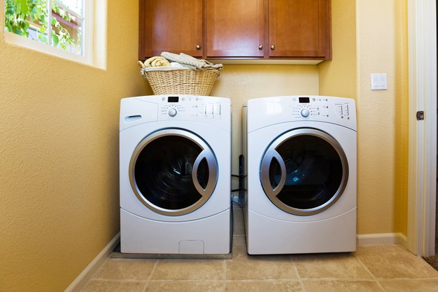 White modern washer and dryer in home's laundry room.