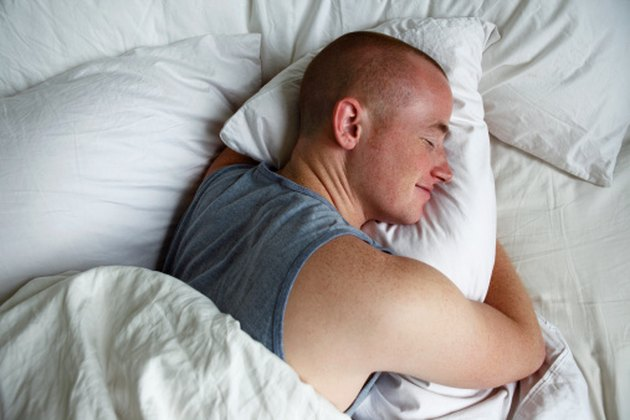 Man resting on comfortable pillow