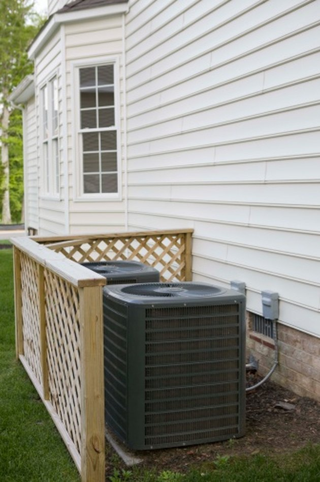 AC condensers outside a home.