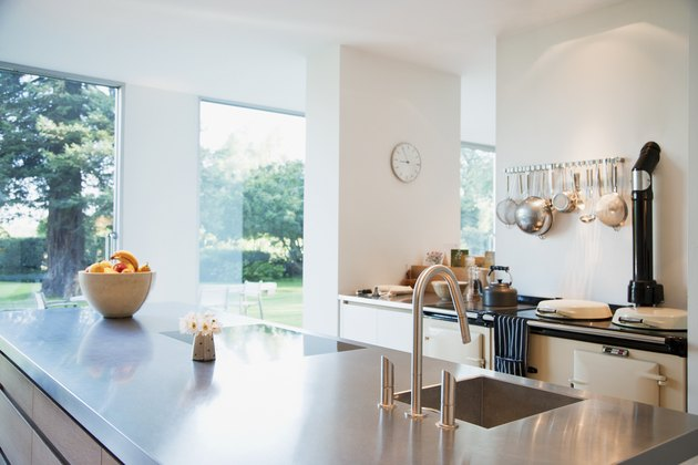 Modern kitchen with stainless steel counters.