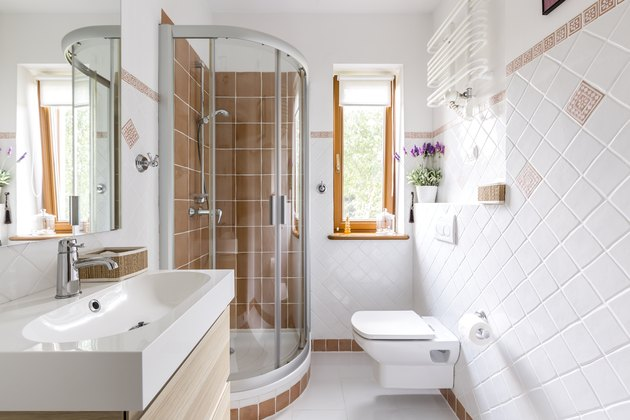 Shower in small white bathroom