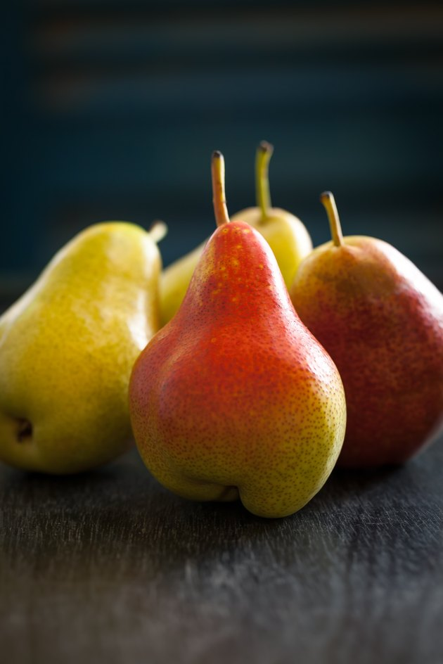 Ripe pears on dark backgound.