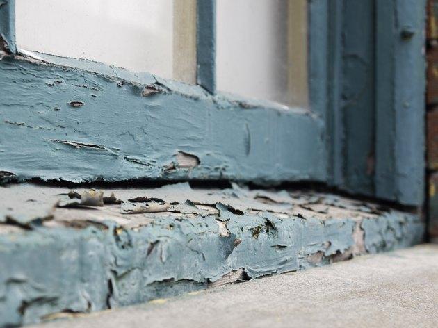 Peeling paint on old window sill