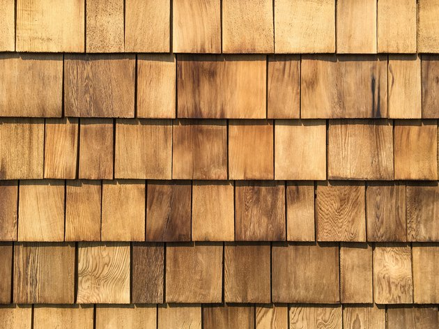 A background of newly roof  installed wooden cedar shingles.