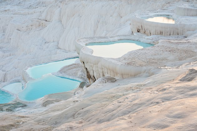 Natural travertine pools and terraces with water in Pamukkale