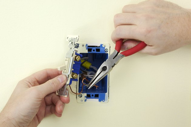 Electrician Replacing A Switch