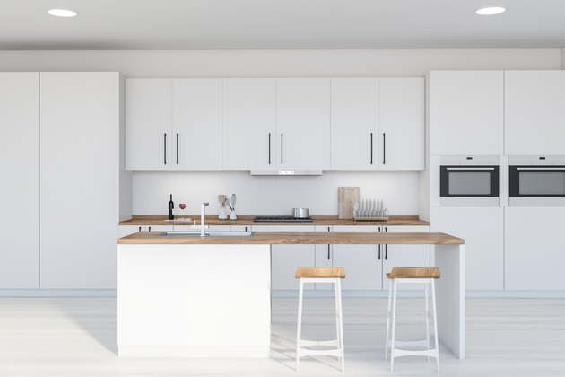 Modern white kitchen interior with bar