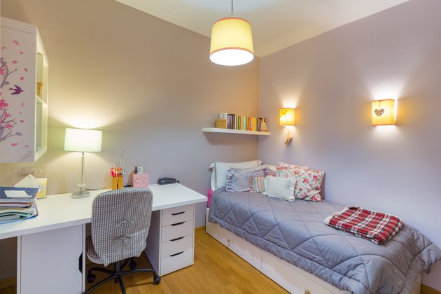 Teenager girl student bedroom.