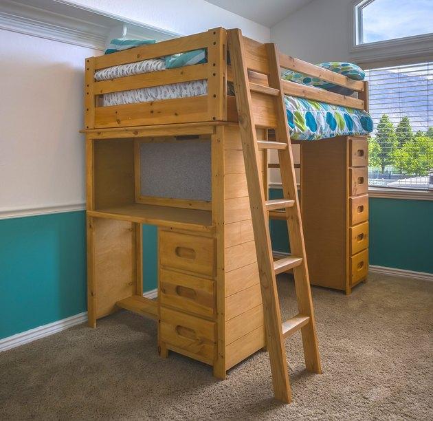 Wooden bunk bed in child's bedroom