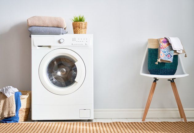 Laundry room with a washing machine.