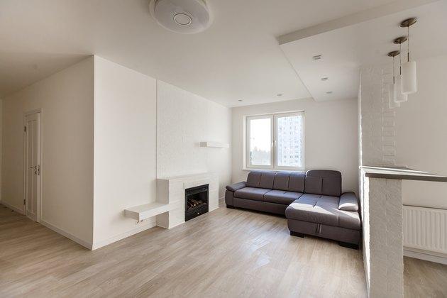 Modern, stylish living room with big gray sofa