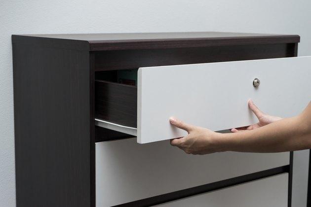 Woman hand open drawer ,wardrobe