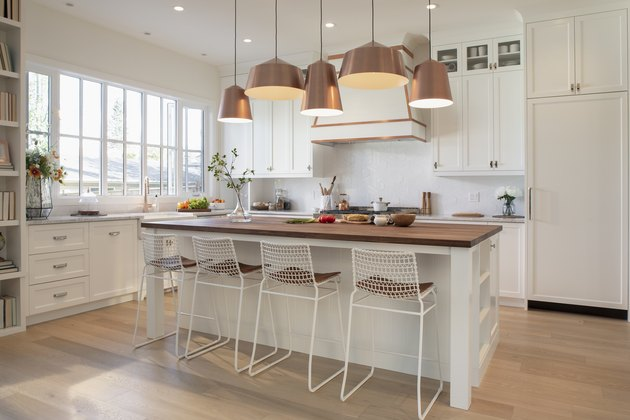 White home showcase interior kitchen with copper pendant lights