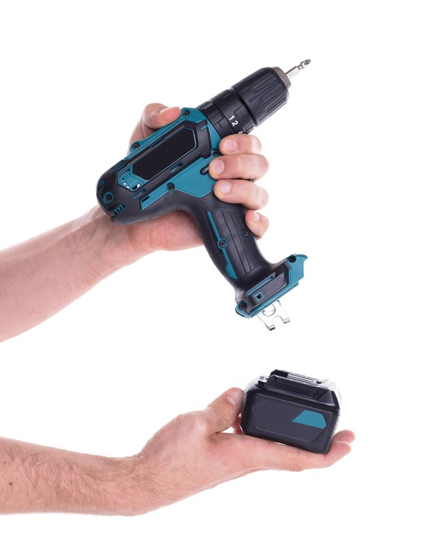 Cordless screwdriver or power drill isolated.