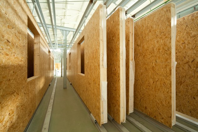 Fiberboard walls lined up in a factory lumber yard