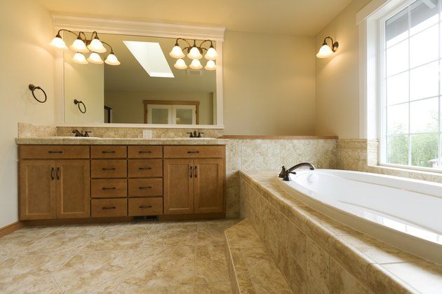 Luxury bathroom with travertine floors
