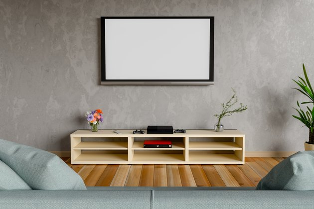 Blank Television Set Mounted On Wall At Home