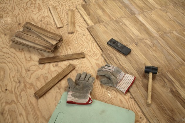 Laying wooden parquet flooring.