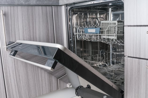 Empty dishwasher machine with opened door