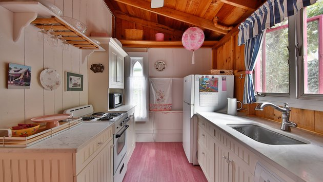 the pink house kitchen white white cabinets and pink floors
