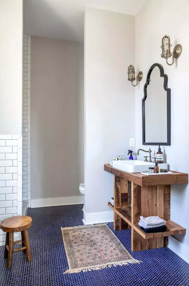 blue and white bathroom with reclaimed wood vanity and deck-mounted faucet