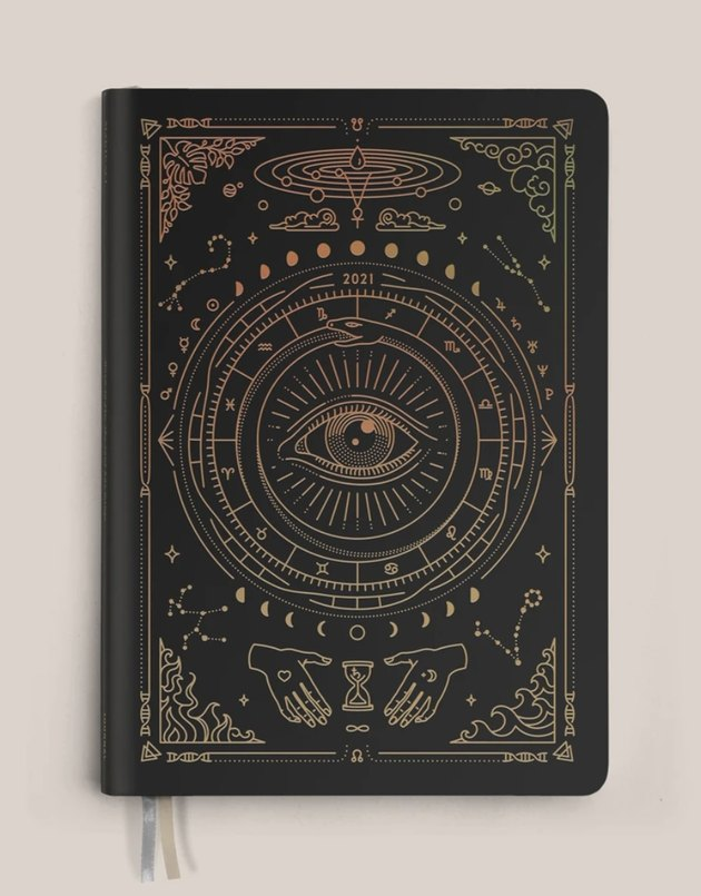 black astrology planner with mystic gold design
