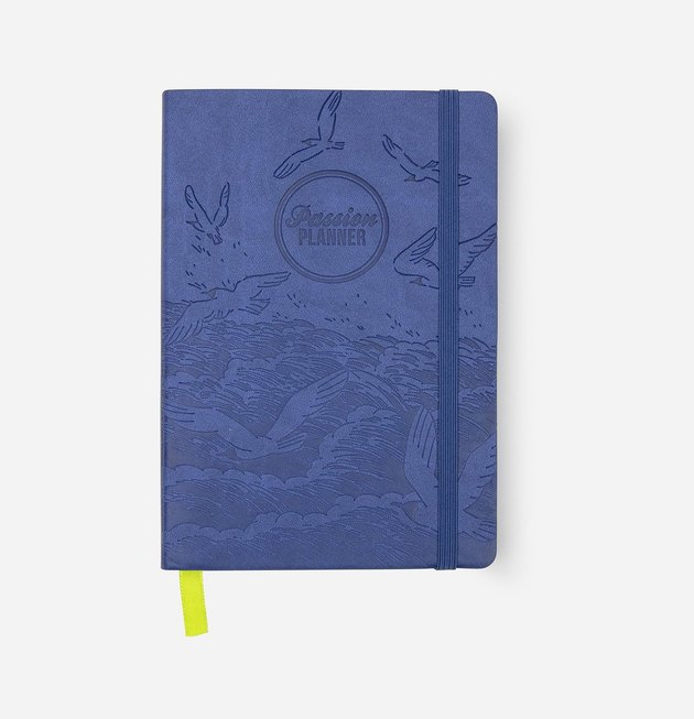 blue planner with waves and birds design and green ribbon