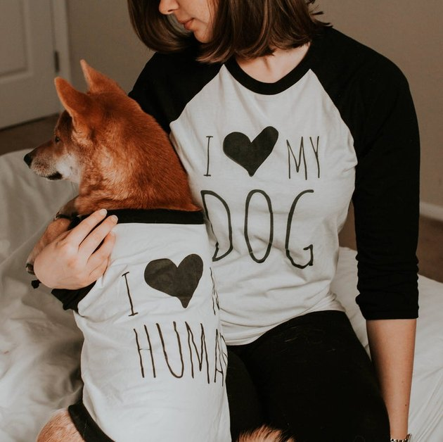 dog and person with matching black and white shirts