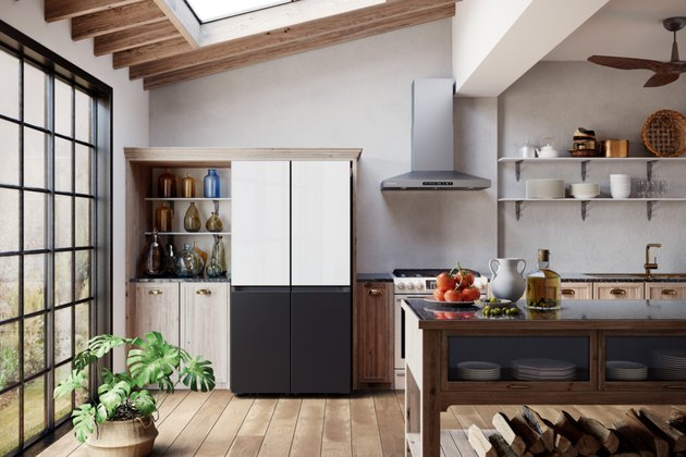 kitchen area with fridge that has four black and white door