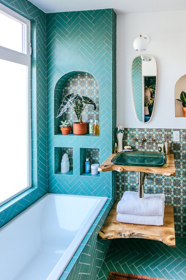 glass drop in bathroom sink with reclaimed wood vanity