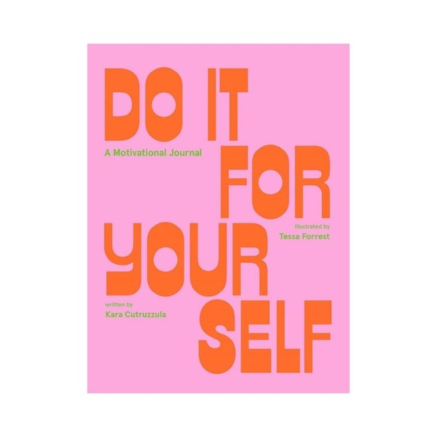 pink journal with orange and green text