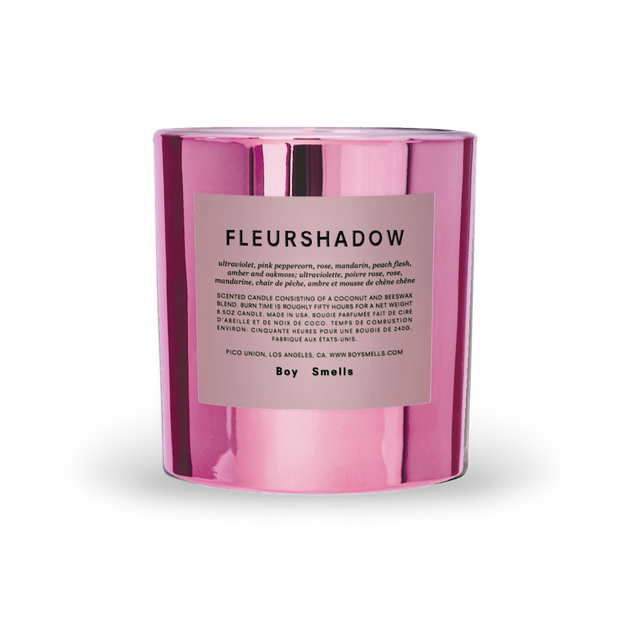 boy smells Fleurshadow candle on white background