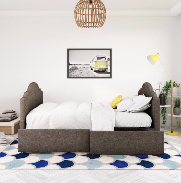 Small Space Daybed Ideas with Upholstered daybed, rattan pendant lamp, bedding, rug, art.
