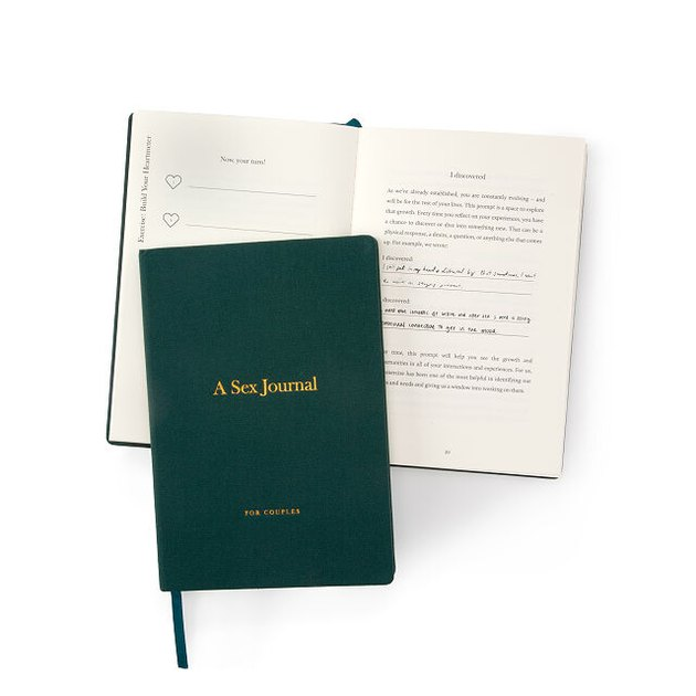 green journal with gold text over open journal