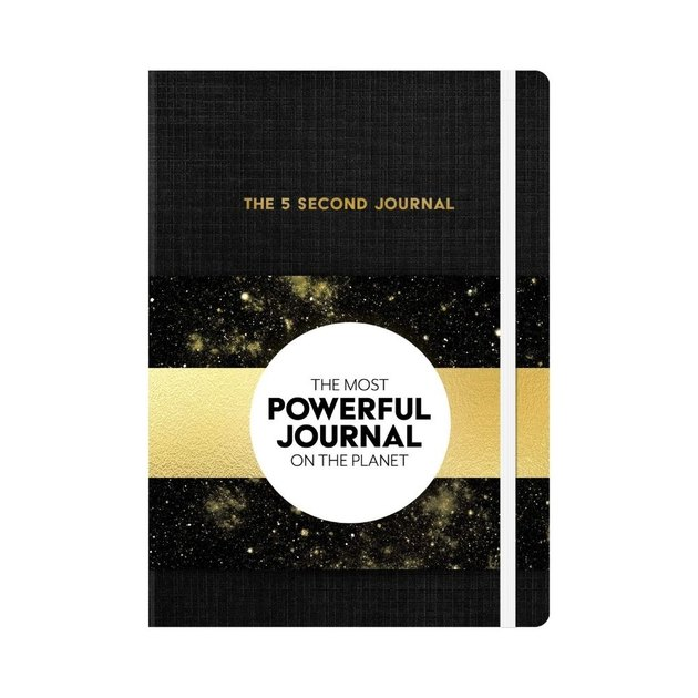 black and gold journal with white circle