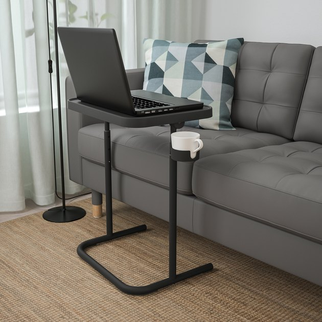 ikea Björkåsen laptop stand in anthracite with black laptop and white mug