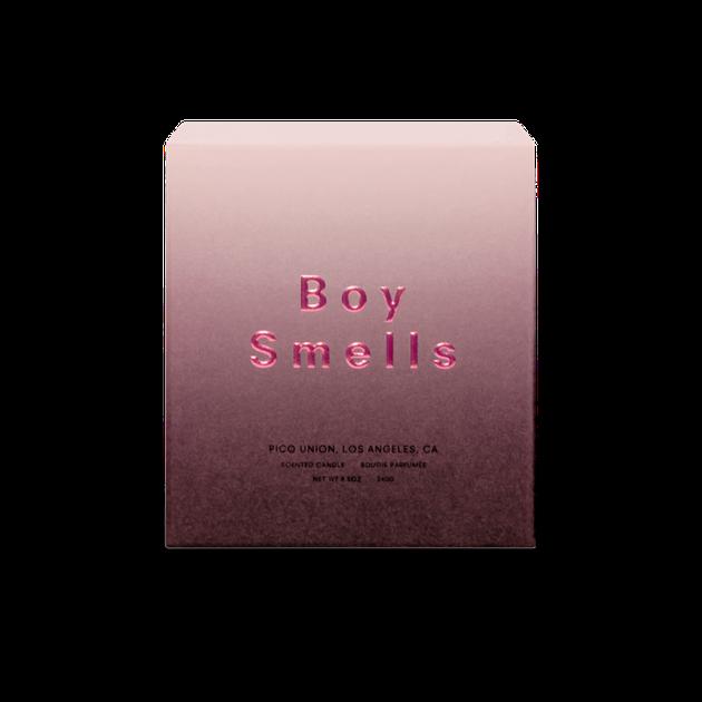 boy smells Fleurshadow candle box on white background