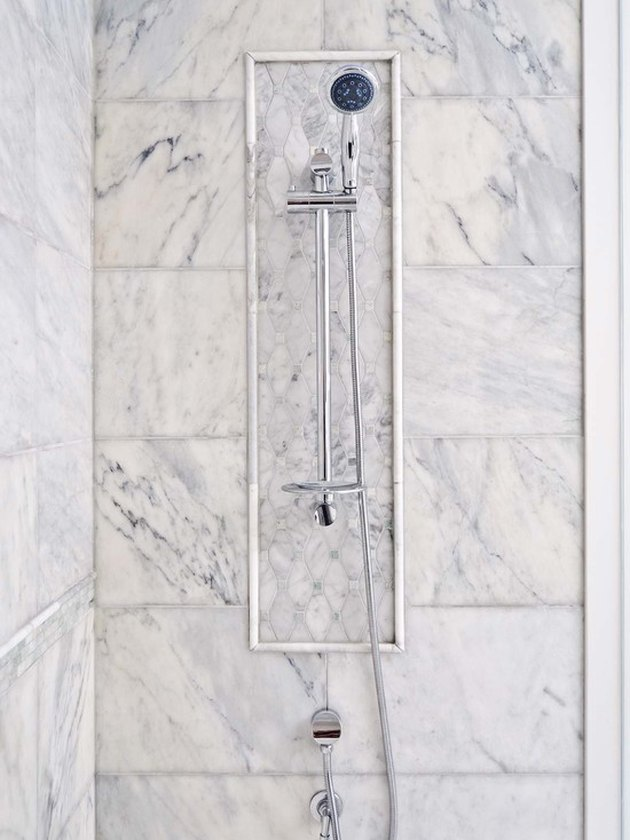 traditional shower fixtures with marble tile surround