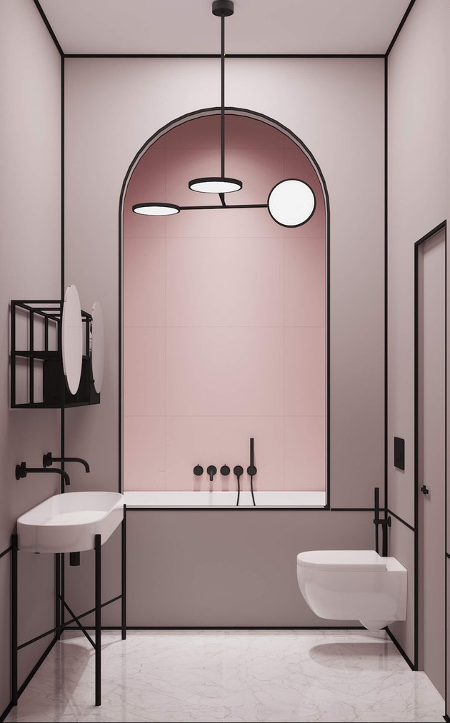 modern bath and shower fixtures in pink and black minimalist bathroom with archway framing the shower