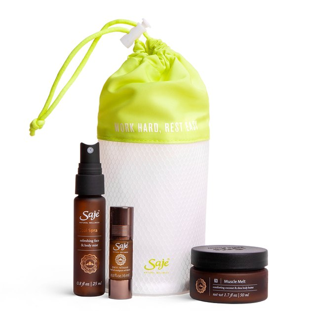 white drawstring bag with lime green top and beauty products