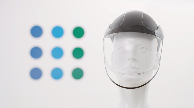 face shield on mannequin with colorful dots in the background
