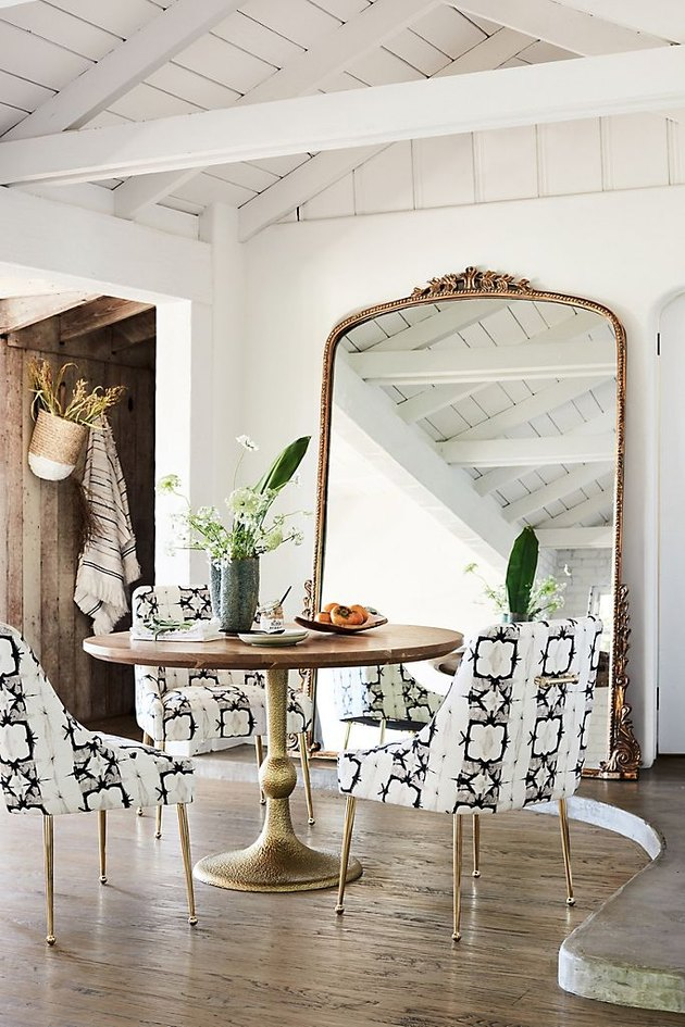 arch crown top mirror in dining room