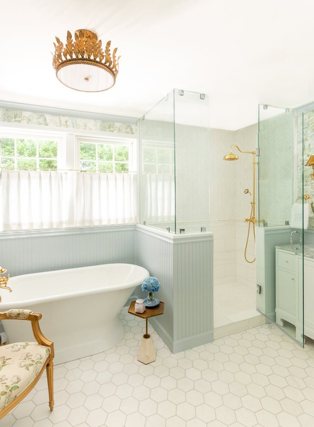 traditional shower fixtures in bathroom with blue tile