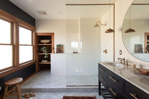 traditional shower fixtures in bathroom with large walk-in shower and wood trim