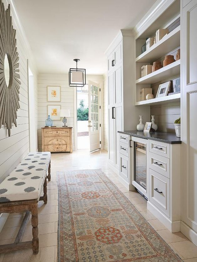 Taupe shiplap hallway designed by Kelley Vieregg Interior Design