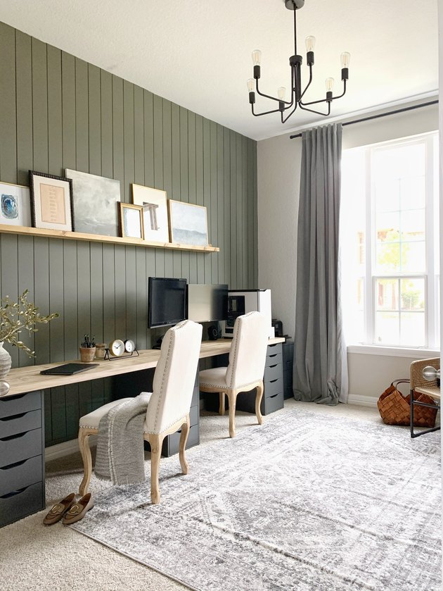 Green home office with shiplap accent wall and double workspace