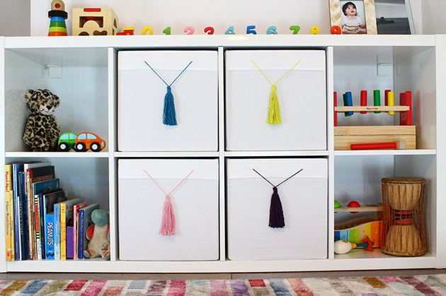 IKEA white boxes with colorful tassels
