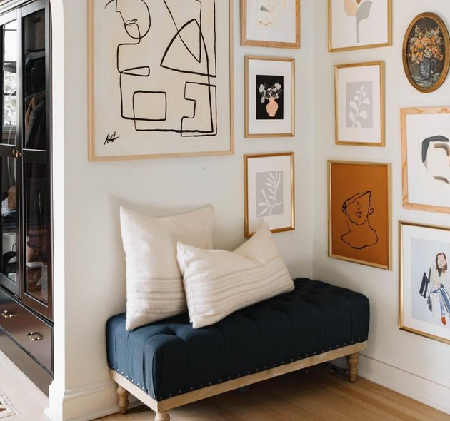 Hallway Gallery Wall Ideas with prints, art, bench, cushions.